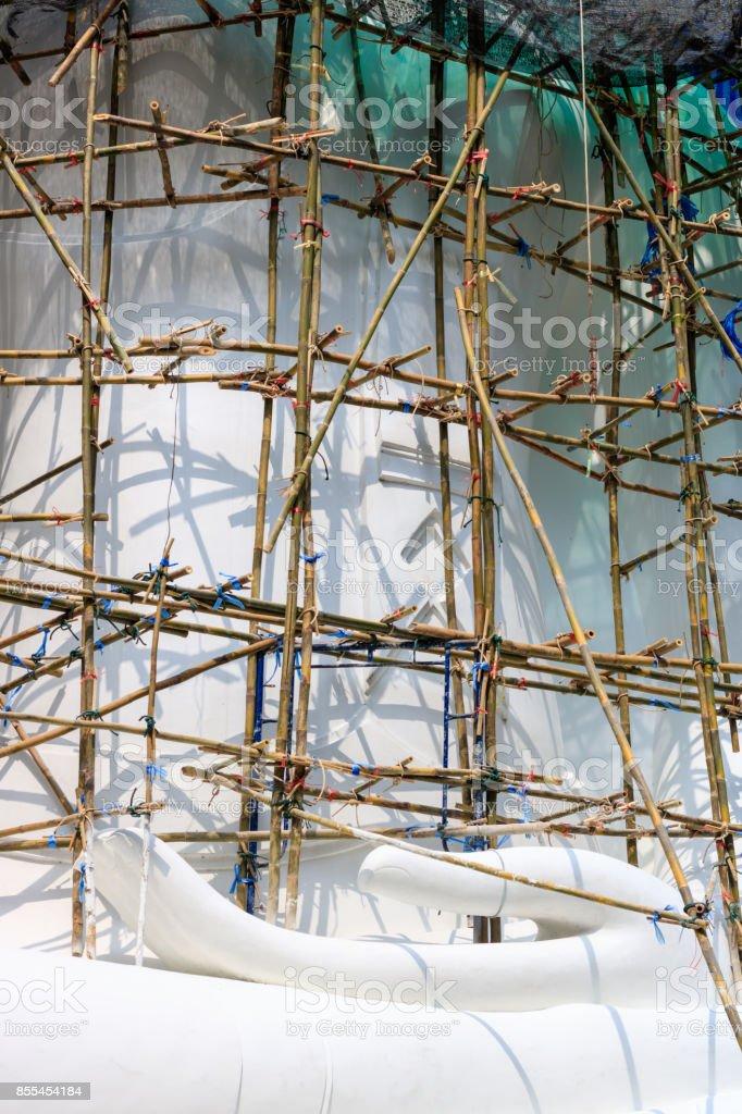 Restoration work on Buddha statue stock photo