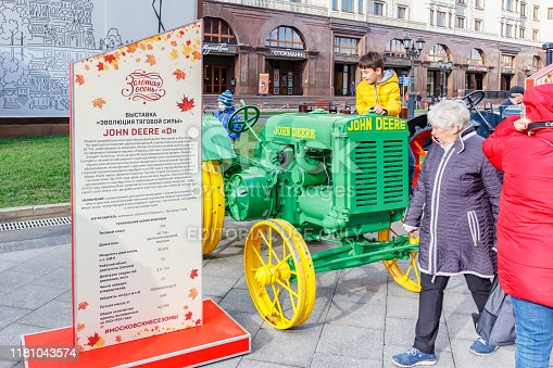 Moscow, Russia - October 08, 2019: Restored american wheel tractor JOHN DEERE D Popping Johnnie on the exhibition of agricultural machinery on Revolution Square in Moscow at sunny autumn day
