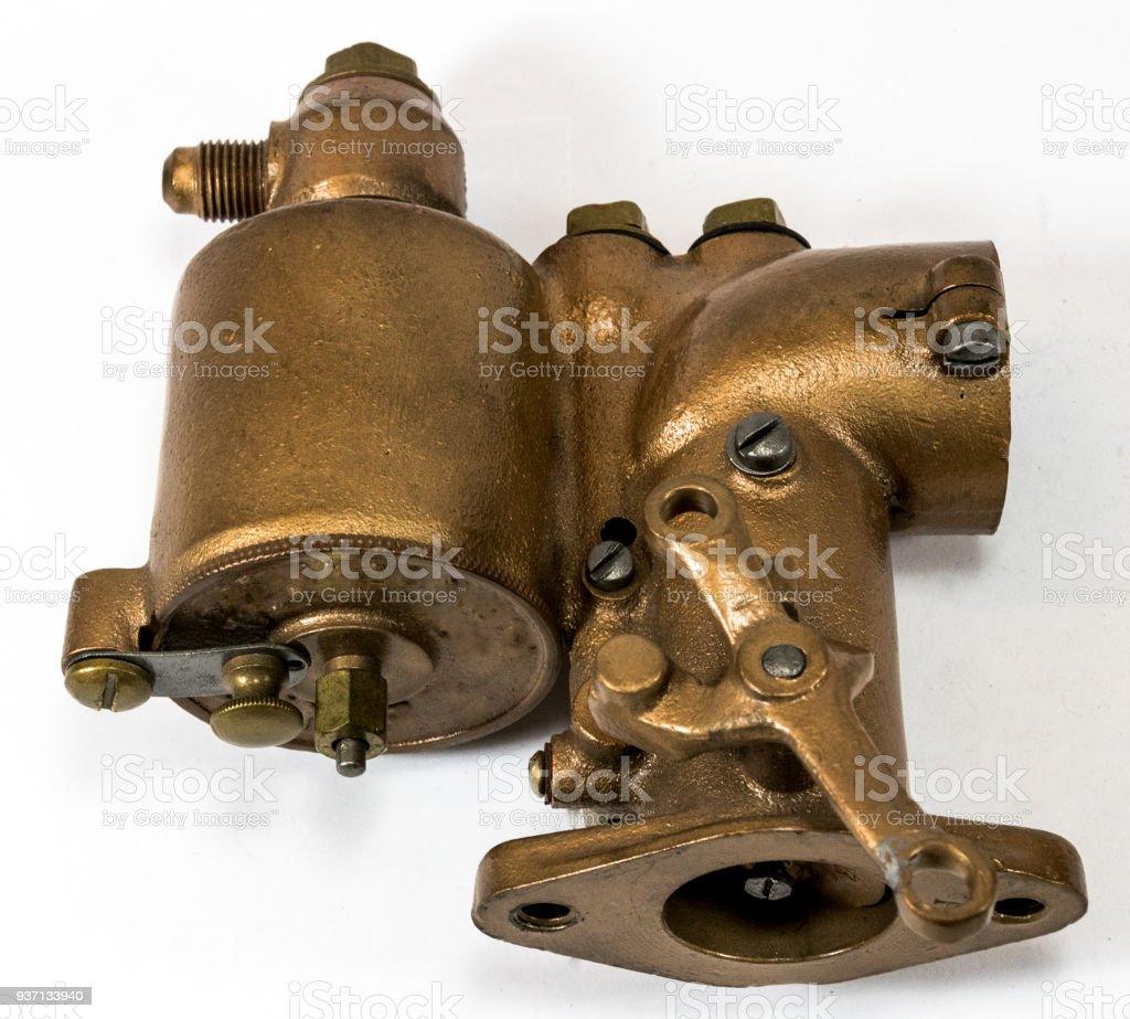 Restored antique automotive brass updraft carburetor stock photo