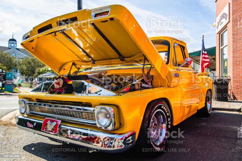 A restored classic Chevrolet pickup truck parked on display at the Matthews Auto Reunion stock photo