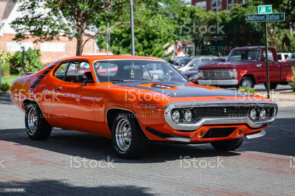 A restored classic Plymouth Road Runner arrives at the Matthews Auto Reunion stock photo