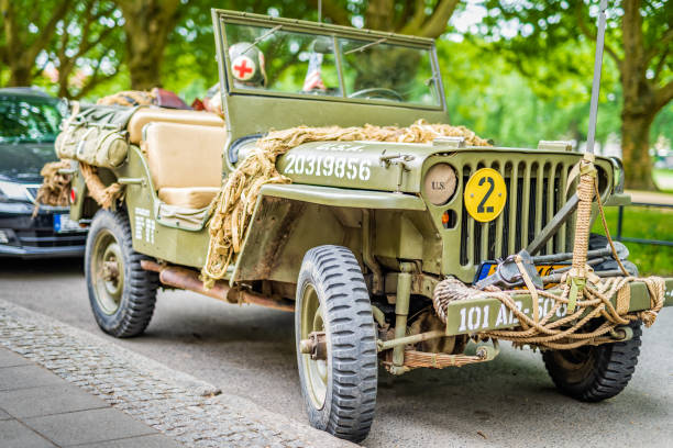 Restored retro Jeep Willis from American Vietnam war or World War 2 Szczecin, Poland, June 2018 Restored retro Jeep Willis from American Vietnam war or World War 2 with vintage equipment, accessories and camouflage willys stock pictures, royalty-free photos & images