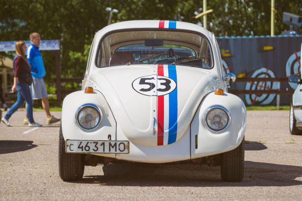 Restored Volkswagen beetle stylized number 53. Parked on the street on a clear sunny day. Front view stock photo