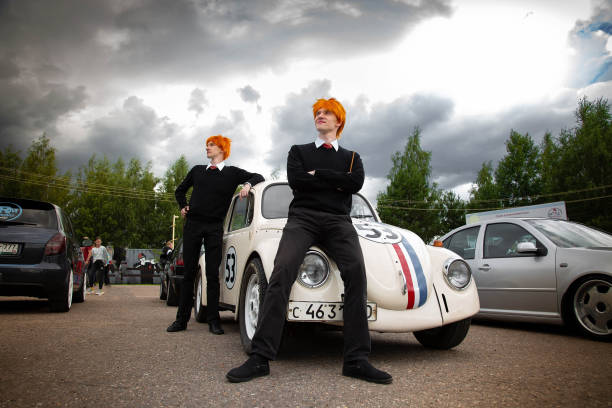 Restored Volkswagen beetle stylized number 53. The Weasley Brothers are standing nearby. Cosplay on the theme of retro and films. stock photo