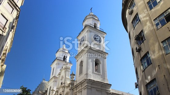Restored white church, with its old two towers in Old Town of Buenos Aires, Argentina, with a clear blue sky on the back