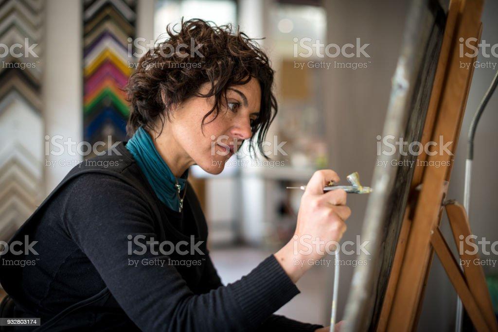 Restorer and framer laboratory craftswomen: Using airbrush stock photo