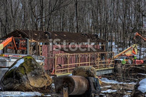 Restoring Burr Arch Covered Bridge as Seen on a Spring Day