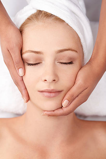 restoring her body's equilibrium - spa treatment stock photos and pictures