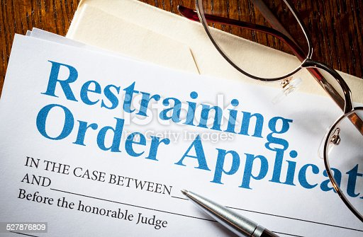 Restraining Order application with glasses and pen