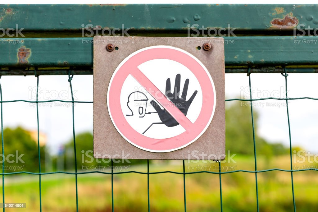 A restricted area no trespassing sign on a fence stock photo