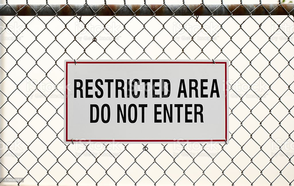 Restricted area sign and fence stock photo