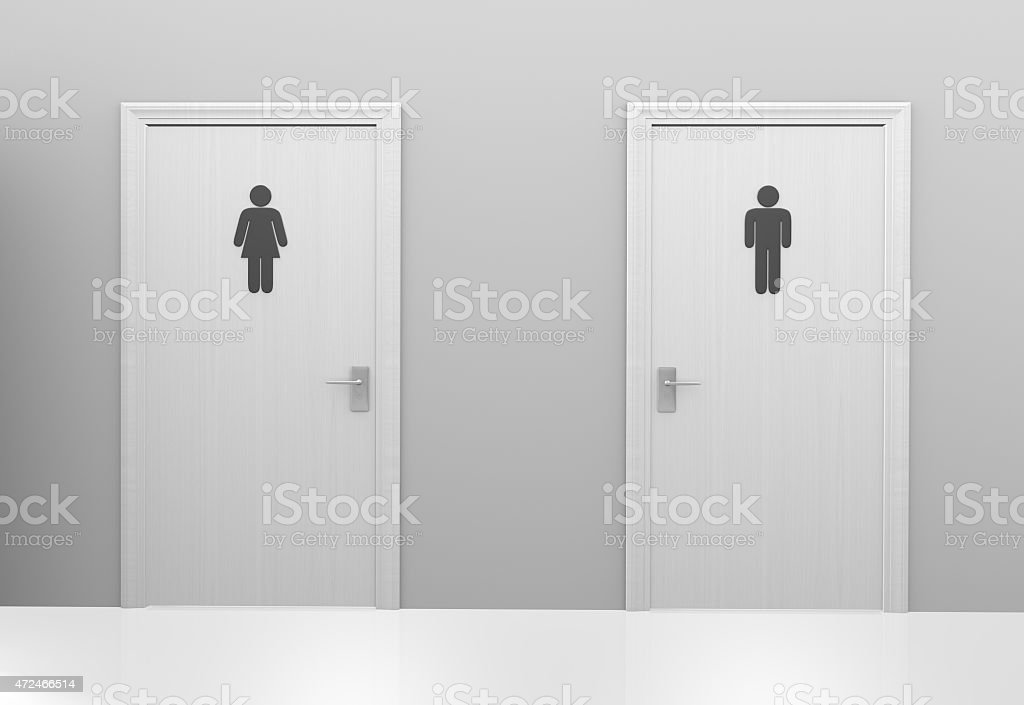 Restroom doors to public toilets with men and women icons stock photo