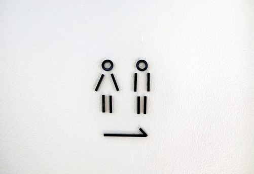 istock Restroom modern sign on a toilet door. Toilet simple sign - Restroom Concept -  Men and women signs for restroom. - Image 1138841635