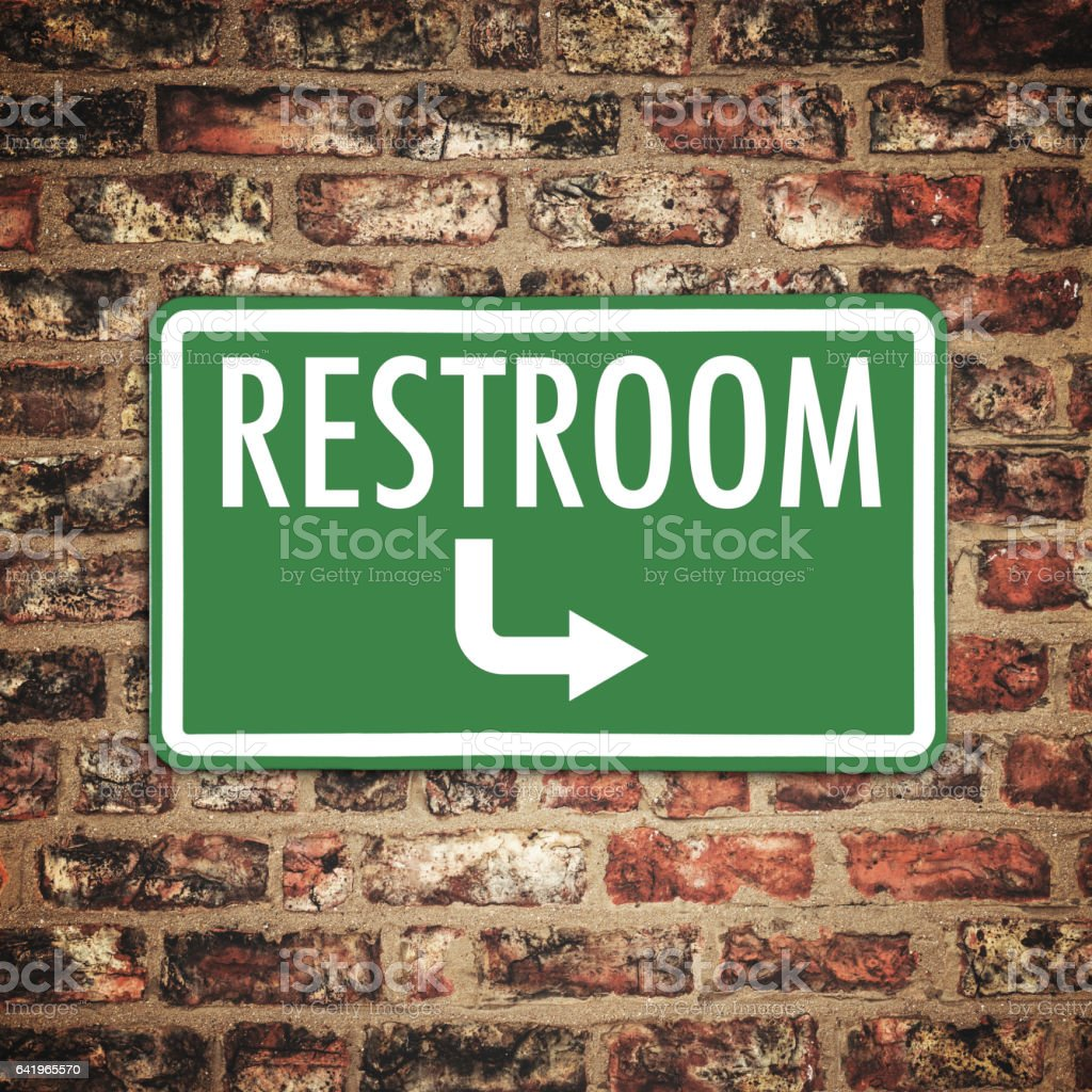 restroom plate on a brick wall stock photo