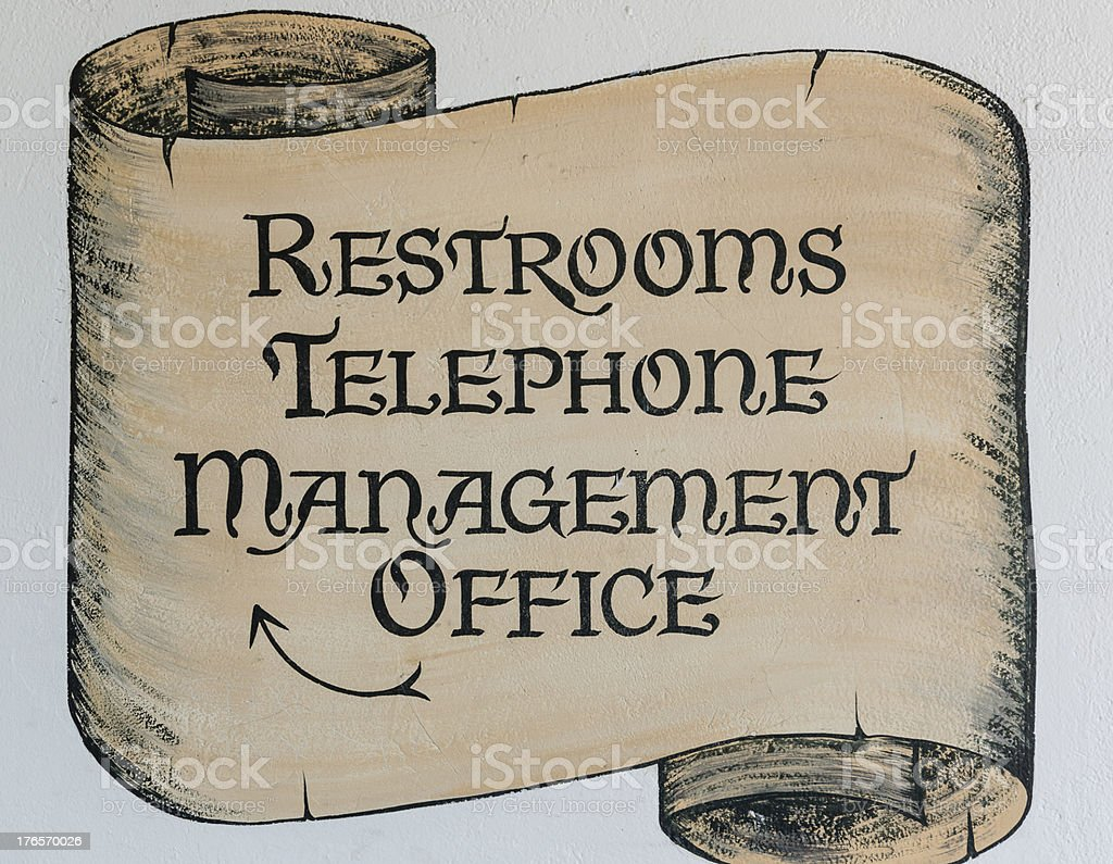 'Restrooms Telephone Management Office' sign royalty-free stock photo