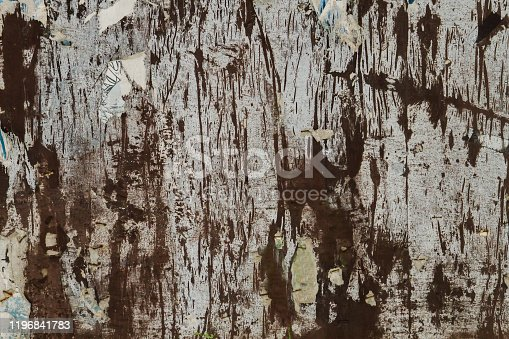531421454 istock photo Rests of paper on old bulletin board 1196841783
