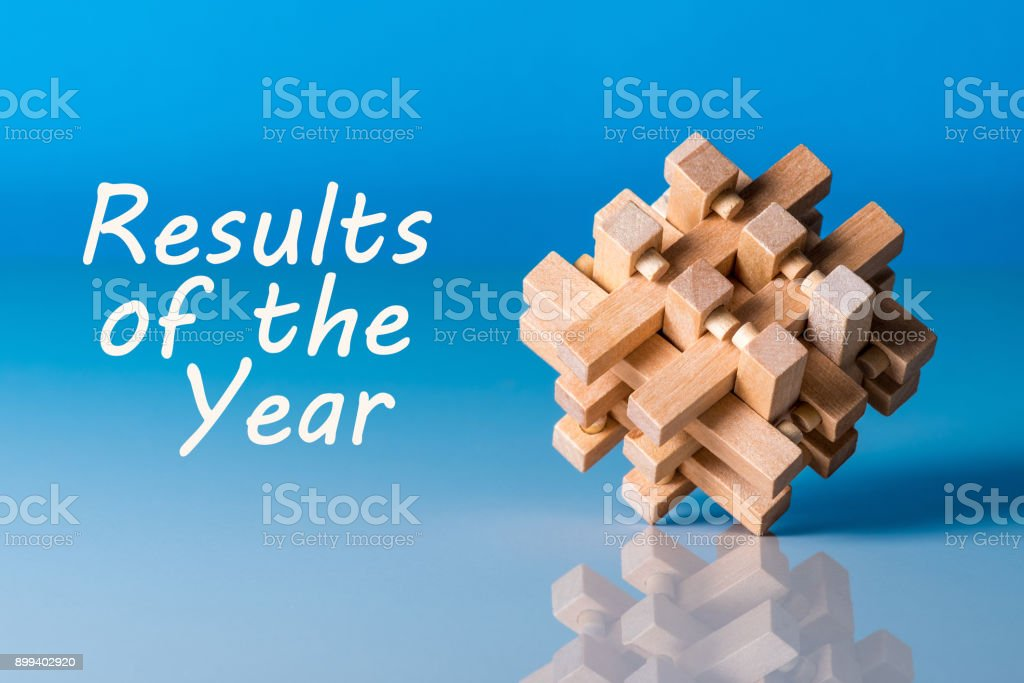 Results of the year - or 2017 Review. Text at blue background with brain teaser stock photo