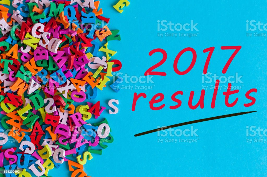 2017 results. Review of the Year. Note at blue surface near many little wooden letters stock photo