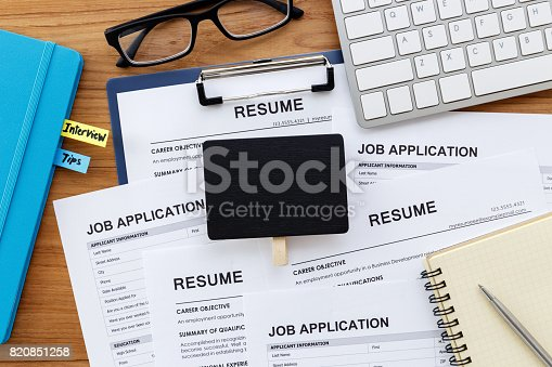 istock Resume and job application with blank sign 820851258