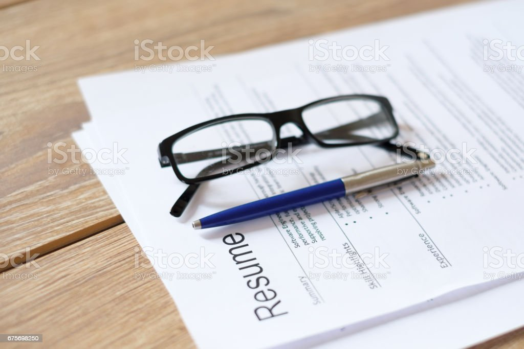 Resume application on wooden desk royalty-free stock photo