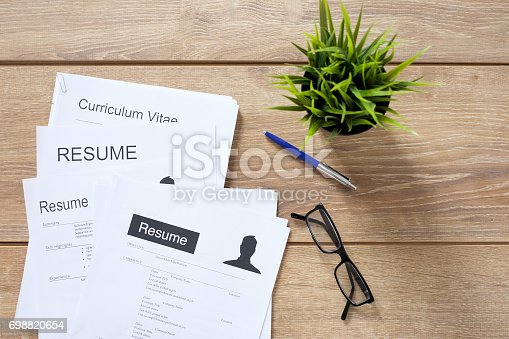 istock Resume applications on the desk ready to be reviewed 698820654