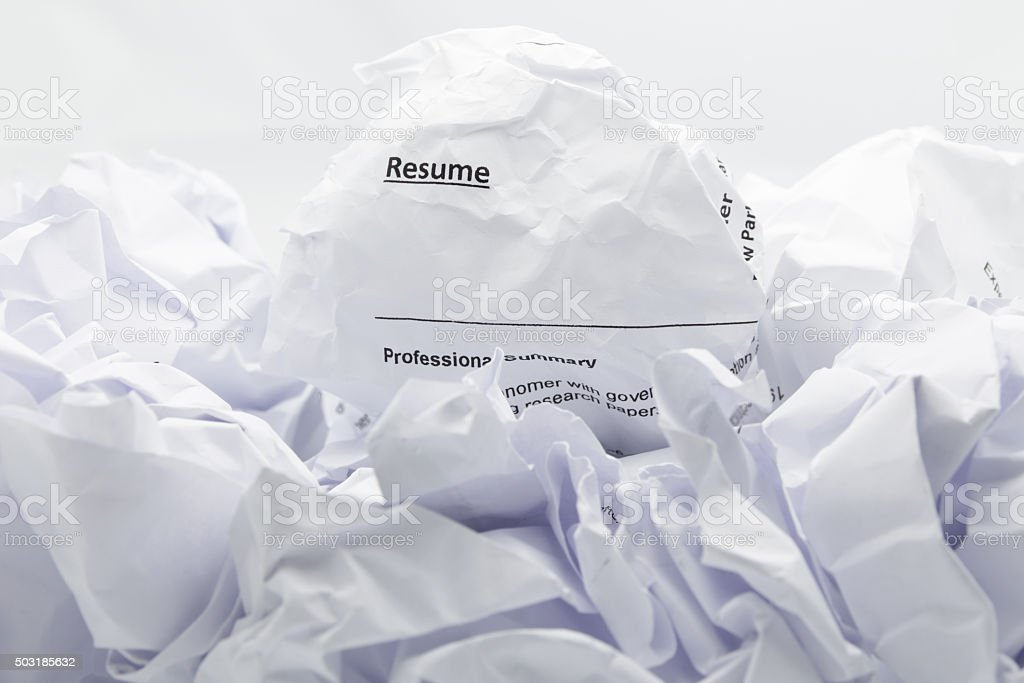 Resume crumpled up and thrown away in the trash. stock photo