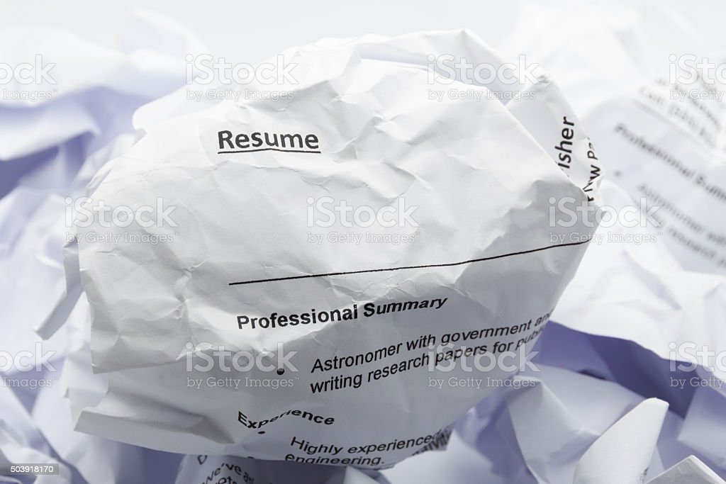 Resume crumpled up and thrown away in the trash stock photo