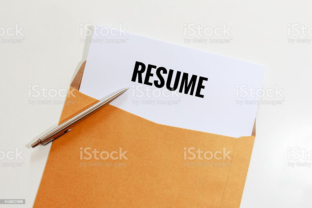 Resume in envelope with pen on table - business concept stock photo