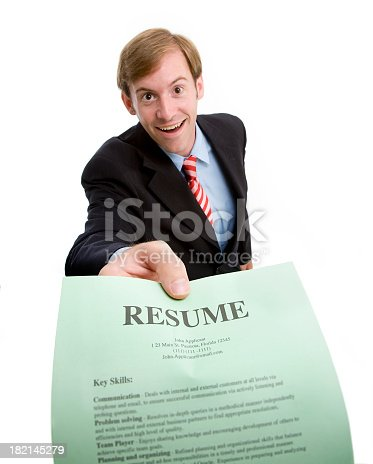 A handsome young businessman presents his resume.