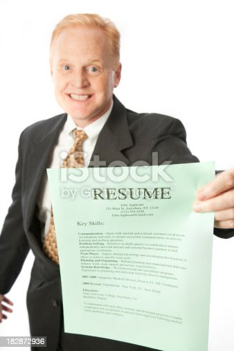 A handsome businessman presents his resume.