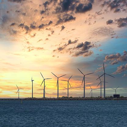 Lowangle shot of Middelgrunden Wind Turbine Offshore Wind Park at sunset outside of Copenhagen in Denmark