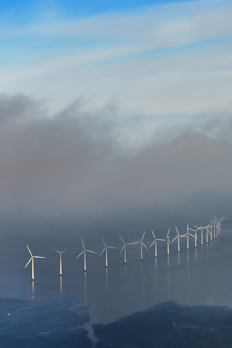 Aerial view of Middelgrunden Wind Turbine Offshore Wind Park outside of Copenhagen on a sunny day in Denmark