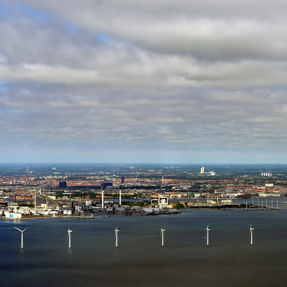 Aerial shot of Middelgrunden Wind Turbine Offshore Wind Park on a sunny day in Denmark