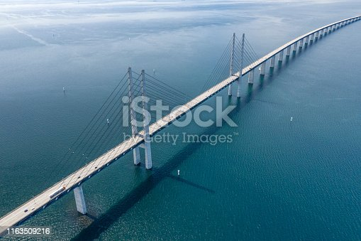 Aerial of the famous Øresund Bridge. The longest combined road and rail bridge in Europe that connects the two major metropolitan areas Copenhagen, the Danish capital city, and the Swedish city of Malmö. Converted from RAW.