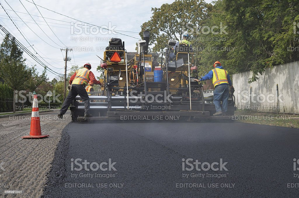 Resurfacing asphalt road stock photo