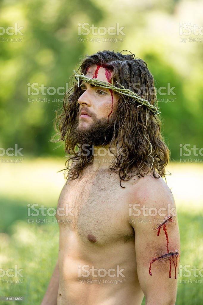 Resurrected Jesus wearing a Crown of Thorns stock photo