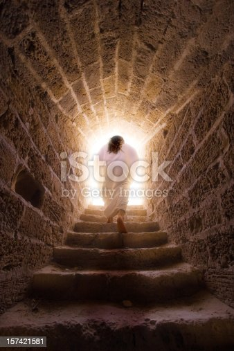Jesus walks out of the tomb in a depiction of the resurrection of Jesus Christ.