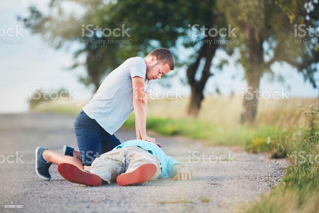 Resuscitation on the rural road stock photo