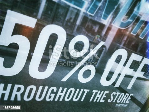 Retail signage that reads 50 percent off. This image was taken and processed with a mobile device.