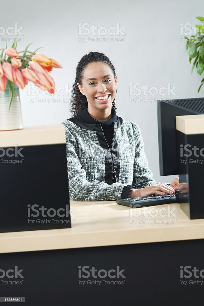 Retail Banking Counter with Friendly Young Woman Bank Teller Vt stock photo