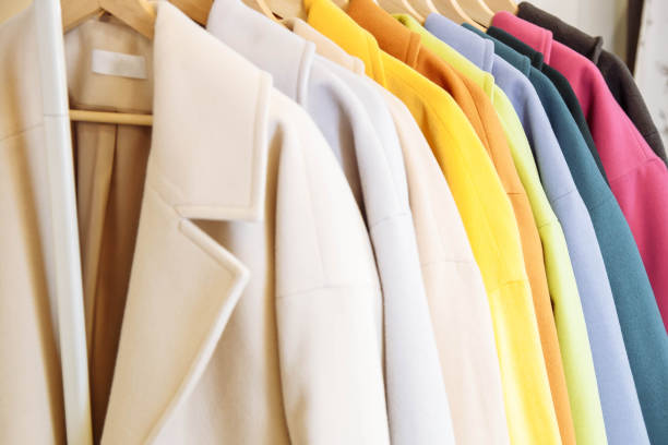 Retail - clothes rail with colorful coats. Retail - clothes rail with colorful coats coat garment stock pictures, royalty-free photos & images