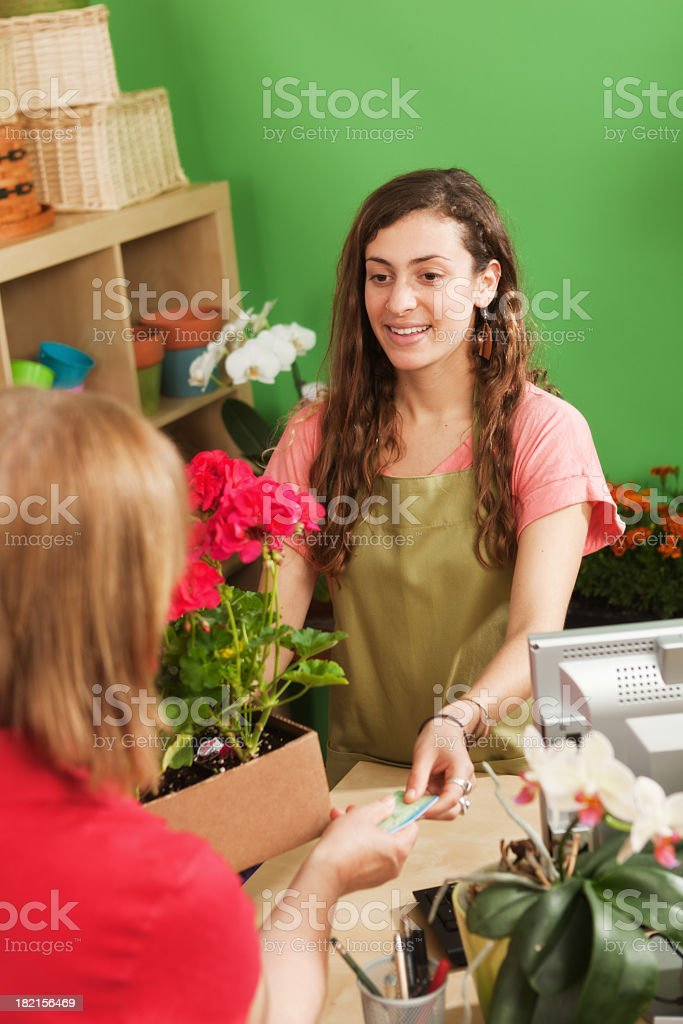 Retail Flower Shop Small Business Sales Clerk Helping Store Customer royalty-free stock photo