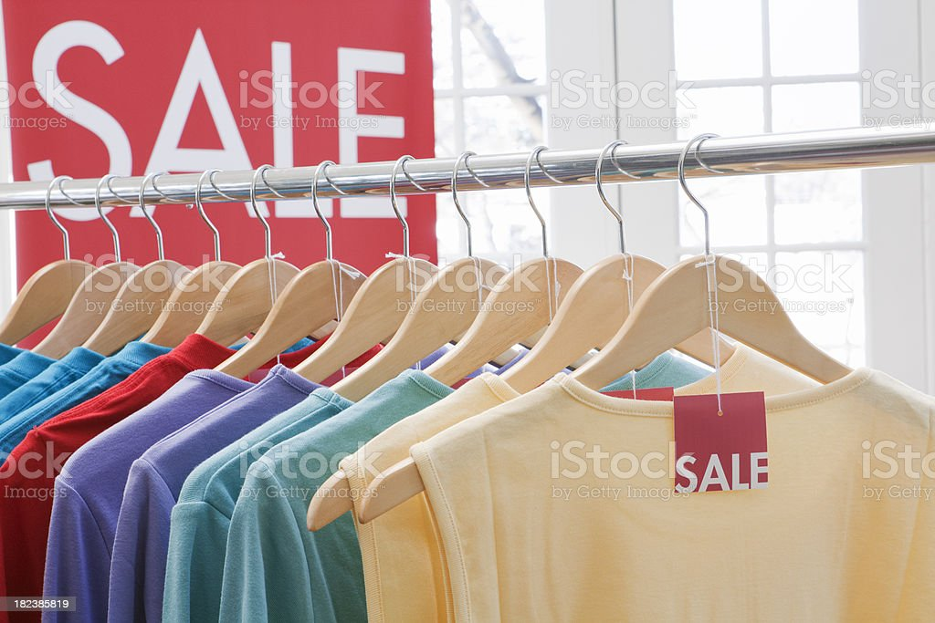 Retail Sale—Clothes Shopping in Fashion Store for Color Tops royalty-free stock photo