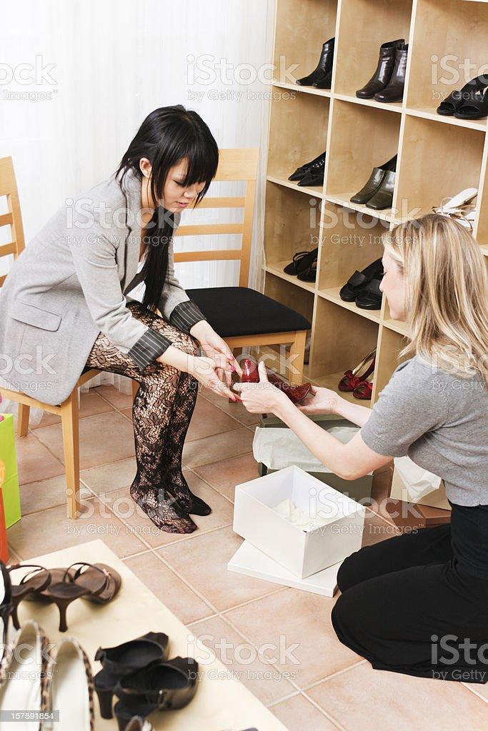 Retail Sales Clerk and Customer in Boutique Shoe Store Vt stok fotoğrafı