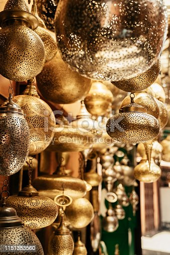 994119256istockphoto Retail store of traditional Moroccan bronze lamps in Marrakech old town (Medina). 1151383560