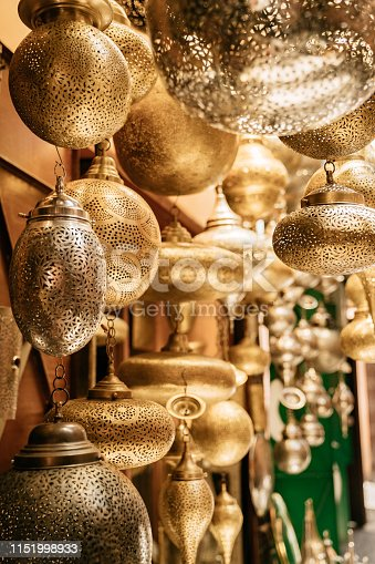 994119256istockphoto Retail store of traditional Moroccan bronze lamps in Marrakech old town (Medina). 1151998933