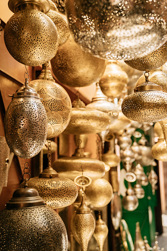 994119256 istock photo Retail store of traditional Moroccan bronze lamps in Marrakech old town (Medina). 1151998933