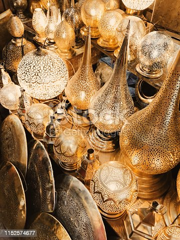 994119256istockphoto Retail store of traditional Moroccan bronze lamps in Marrakech old town (Medina). 1152574677