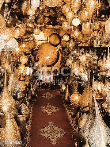 994119256istockphoto Retail store of traditional Moroccan bronze lamps in Marrakech old town (Medina). 1152574680