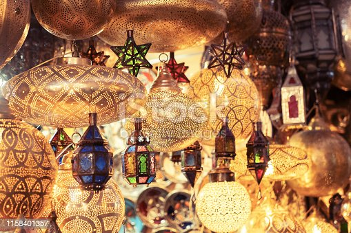 994119256istockphoto Retail store of traditional Moroccan bronze lamps in Marrakech old town (Medina). 1158401357